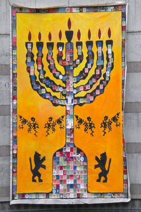 Menorah Artwork hanging on exterior wall at Skirball Cultural Center